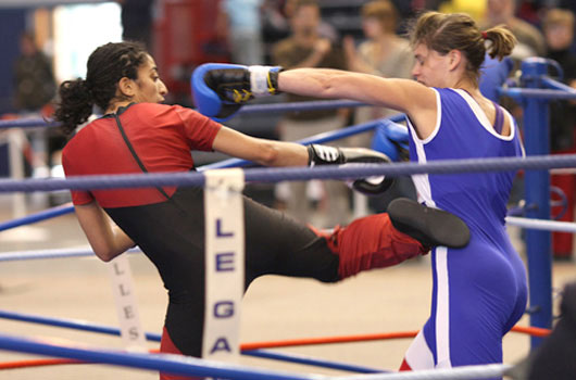 female savate boxers competing in ring